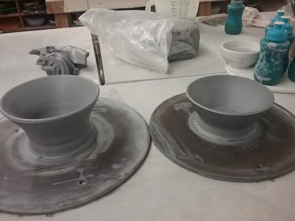 Handcrafted pottery during the drying process.